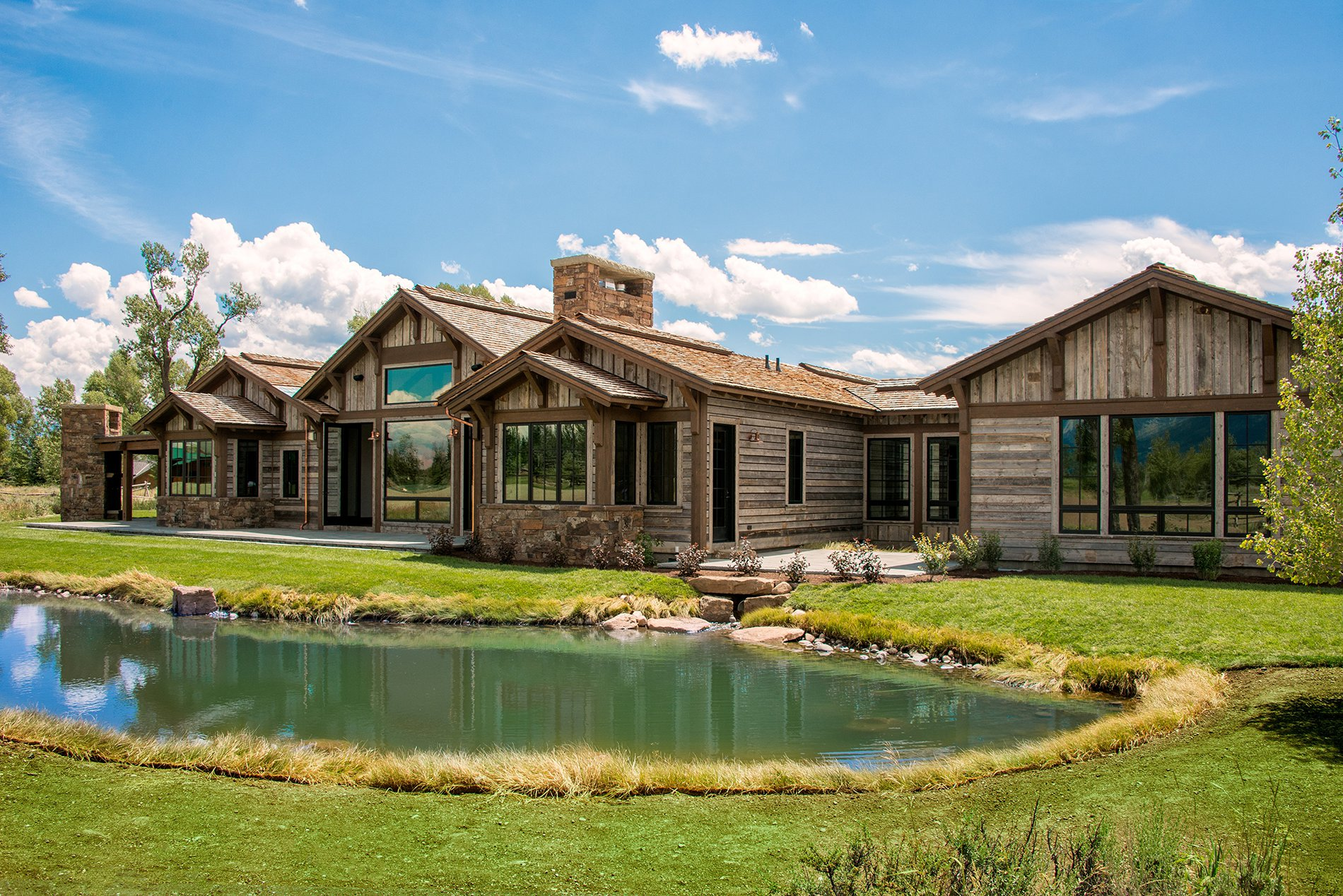 wooden home with outdoor pond