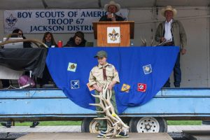 A Boy Scout auctions antlers at the annual ElkFest.